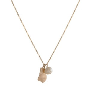 "Dainty gold tone necklace with a state of Georgia pendant and a freshwater pearl accent. Approximately 16"" in length."