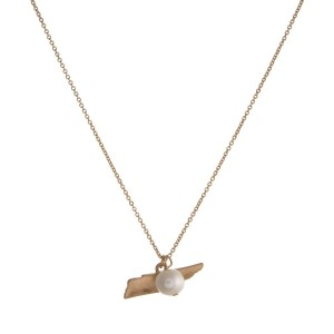 "Dainty gold tone necklace with a state of Tennessee pendant and a freshwater pearl accent. Approximately 16"" in length."