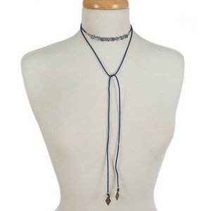 """Blue faux suede wrap choker featuring sodalite beads. Approximately 12"""" in length."""