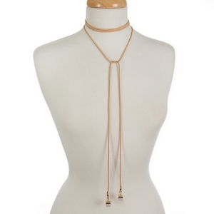 """Tan faux suede wrap necklace featuring rose quartz natural stones on the ends. Approximately 12"""" and 21"""" in length."""