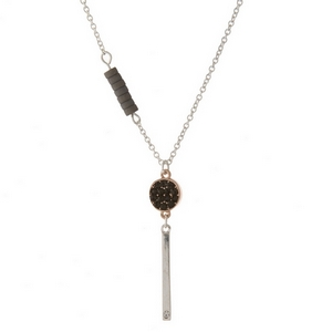 """Two sided, silver and rose gold tone necklace with gray accents and a bar pendant stamped with """"Loved."""""""