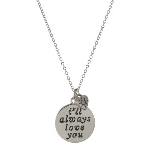 """Dainty silver tone necklace featuring a double sided pendant, stamped with """"I'll Always Love You"""" on one side. Approximately 16"""" in length."""