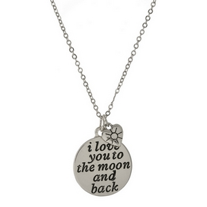 "Dainty silver tone necklace featuring a double sided pendant, stamped with ""I love you to the moon and back"" on one side. Approximately 16"" in length."