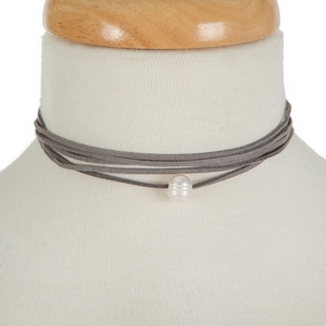 """Gray faux suede wrap necklace with a freshwater pearl bead. Approximately 60"""" in length."""