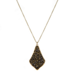 "Gold tone necklace featuring teardrop shaped pendant embellished with hematite and gold rhinestones. Approximately 32"" in length."