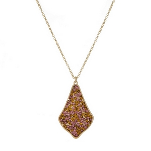 "Gold tone necklace featuring teardrop shaped pendant embellished with topaz and peach rhinestones. Approximately 32"" in length."