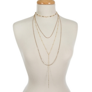 """Gold tone dainty layered necklace featuring blush, ivory and freshwater pearl beads. Approximately 13"""" to 30"""" in length."""