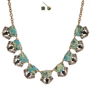 """Gold tone necklace set with turquoise and mint speckled stones, surrounded by gray rhinestones and matching stud earrings. Approximately 16"""" in length."""