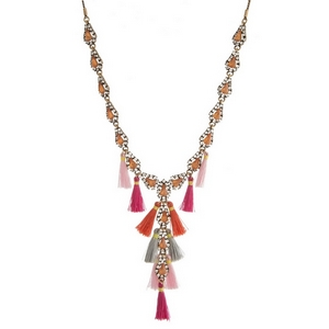 """Burnished gold tone 'Y' necklace with peach rhinestones and gray, pink and coral tassels. Adjustable from 16"""" to 32"""" in length."""