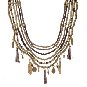 """Gold tone, ivory and burgundy beaded bib necklace with hammered and tassel charms. Approximately 16"""" in length."""