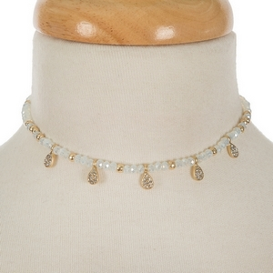 """Gold tone choker featuring opal beads and clear rhinestone accents. Approximately 12"""" in length."""