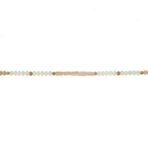 """Ivory, champagne and opal beaded choker with gold tone accents. Approximately 12"""" in length."""