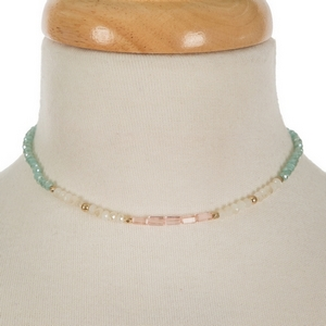"""Mint green, ivory and pink beaded choker with gold tone accents. Approximately 12"""" in length."""