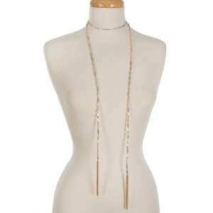 """Ivory and gold tone beaded wrap necklace featuring chain tassels on the ends. Approximately 60"""" in length."""