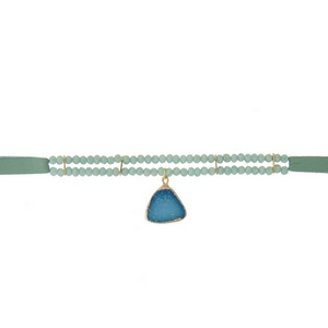 """Mint green leather choker featuring mint green faceted beads and a blue druzy stone pendant. Approximately 12"""" in length."""