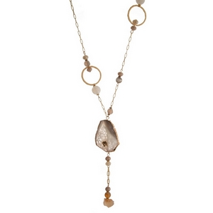 """Gold tone necklace featuring ivory natural stones and champagne faceted beads. Approximately 32"""" in length."""