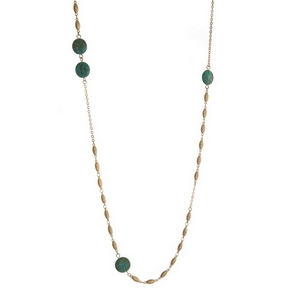 """Gold tone necklace featuring turquoise natural stones. Approximately 38"""" in length."""