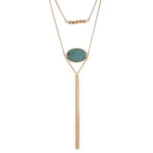 """Gold tone two layer necklace featuring a turquoise natural stone pendant and a chain tassel. Approximately 14"""" and 16"""" in length."""