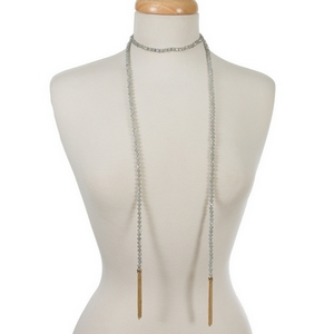 """Gray iridescent beaded wrap necklace featuring gold tone chain tassels on the ends. Approximately 50"""" in length."""