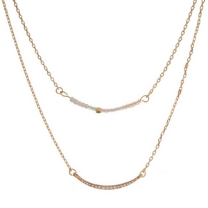 """Dainty gold tone two layer necklace featuring a white beaded bar pendant and clear rhinestone pave bar pendant. Approximately 13"""" and 16"""" in length."""