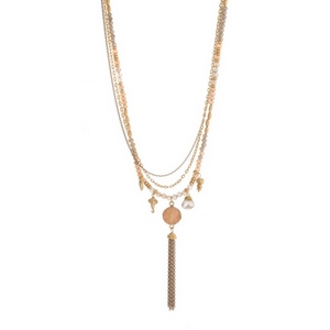 """Gold tone layered necklace featuring gray and topaz beads and a chain tassel. Approximately 26"""" to 30"""" in length."""
