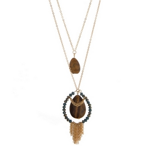"""Gold tone two layer necklace featuring two tiger's eye natural stones, teal faceted beads and chain fringe. Approximately 21"""" and 28"""" in length."""