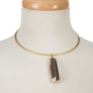 """Gold tone metal choker featuring a gray natural stone pendant. Approximately 5/5"""" in diameter."""