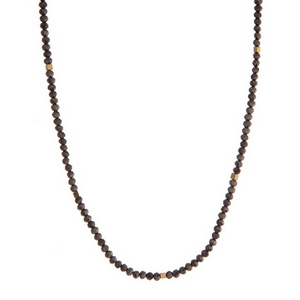 """Dainty black and gold tone beaded necklace. Approximately 16"""" in length."""