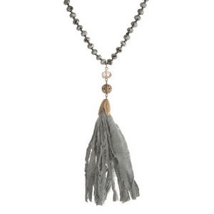 """Hematite beaded necklace featuring a gray tassel and gold tone accents. Approximately 34"""" in length."""