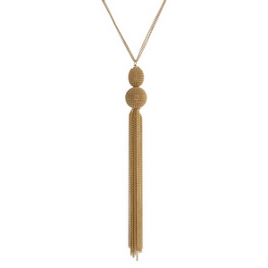 "Gold tone necklace featuring a chain tassel. Approximately 30"" in length."