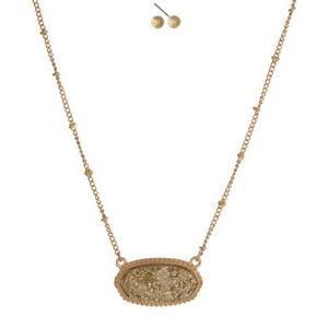 """Gold tone necklace set featuring a gold faux druzy stone and matching stud earrings. Approximately 16"""" in length."""