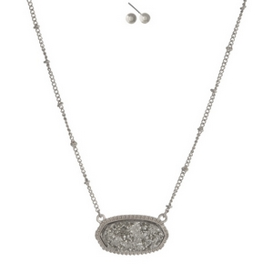 """Silver tone necklace set featuring a gray faux druzy stone and matching stud earrings. Approximately 16"""" in length."""