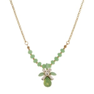 """Gold tone necklace with light green beads and a light green rhinestone pendant. Approximately 16"""" in length."""