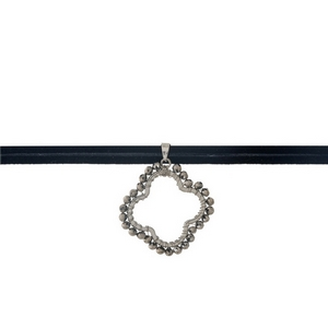 """Black faux suede wrap choker with a gray beaded clover pendant. Approximately 24"""" in length."""