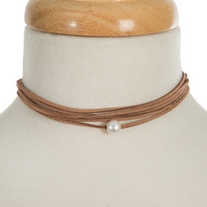 """Brown faux suede wrap necklace featuring a freshwater pearl bead. Approximately 60"""" in length."""