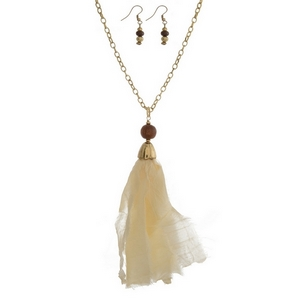 """Gold tone necklace set with an ivory fabric pendant and matching fishhook earrings. Approximately 32"""" in length. Tassel is approximately 5.5"""" in length."""