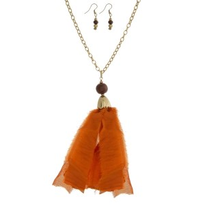 """Gold tone necklace set with an orange fabric pendant and matching fishhook earrings. Approximately 32"""" in length. Tassel is approximately 5.5"""" in length."""