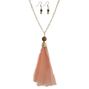 """Gold tone necklace set with a pink fabric pendant and matching fishhook earrings. Approximately 32"""" in length. Tassel is approximately 5.5"""" in length."""