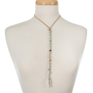 """Tan faux suede cord necklace with an amazonite and ivory beaded pendant. Adjustable from 12"""" to 26"""" in length."""