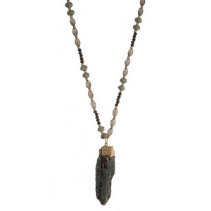 """Gray and iridescent beaded gray cord necklace with a crystal pendant. Approximately 30"""" in length."""