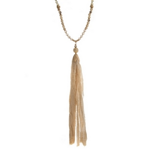"""Gold tone necklace with an ivory beaded chain and an ivory fabric tassel. Necklace is approximately 34"""" in length and tassel is 8"""" in length."""