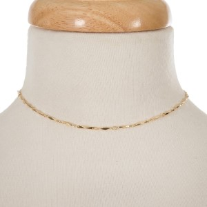 """Gold tone choker with connecting oval shapes. Approximately 12"""" in length."""