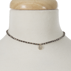 """Hematite and bronze beaded choker with a gold tone pave charm. Approximately 12"""" in length."""