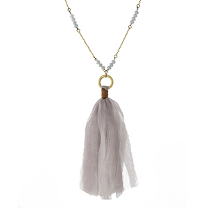 """Burnished gold tone necklace with gray beads and a fabric tassel pendant. Approximately 32"""" in length."""