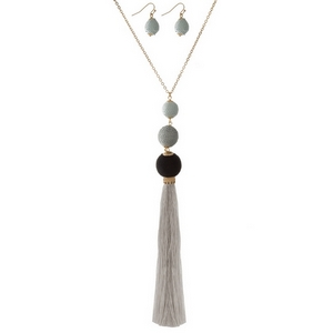 """Gold tone necklace set with gray, thread wrapped beads, a thread tassel and matching fishhook earrings. Approximately 32"""" in length."""