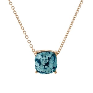 "Gold tone necklace with an aqua glitter, square pendant. Approximately 16"" in length."