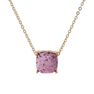 "Gold tone necklace with a pink glitter, square pendant. Approximately 16"" in length."