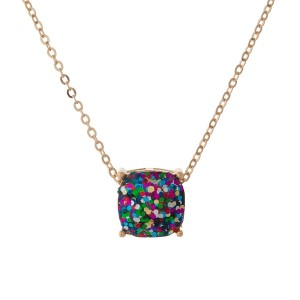 "Gold tone necklace with a multicolored glitter, square pendant. Approximately 16"" in length."