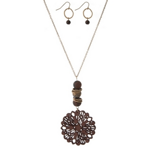 """Gold tone necklace set with a wooden, burgundy, laser cut pendant and natural stone accents. Approximately 32"""" in length."""