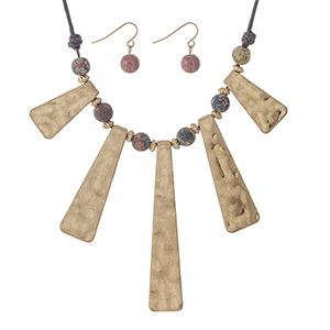 "Brown cord necklace set with gold tone pendants and hunter green natural stone beads. Approximately 18"" in length."